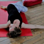 Woman in reclined yoga pose