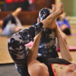 Yogi practicing reclined pigeon pose at Yoga Space Leeds