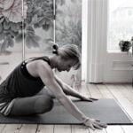 Yoga practice at home crossed legged forward fold