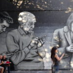 Mural of people on their phone, reduce screen time