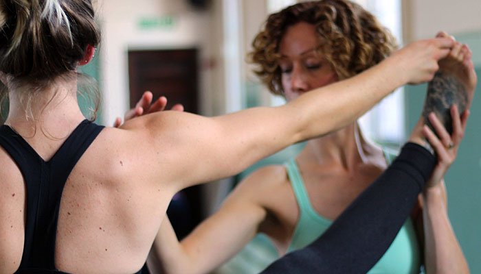 Leeds Yoga Teacher Training, practicing and adjusting